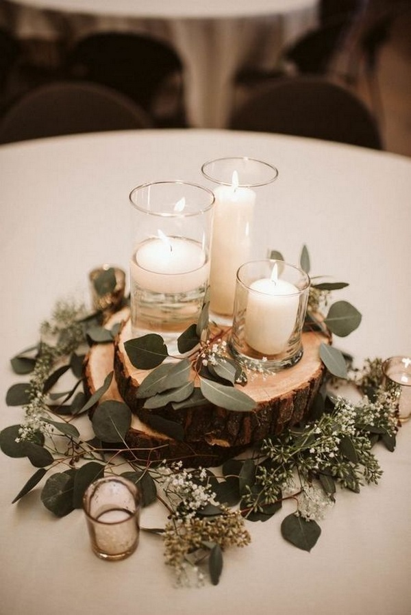 budget friendly simple wedding centerpiece with candles and greenery