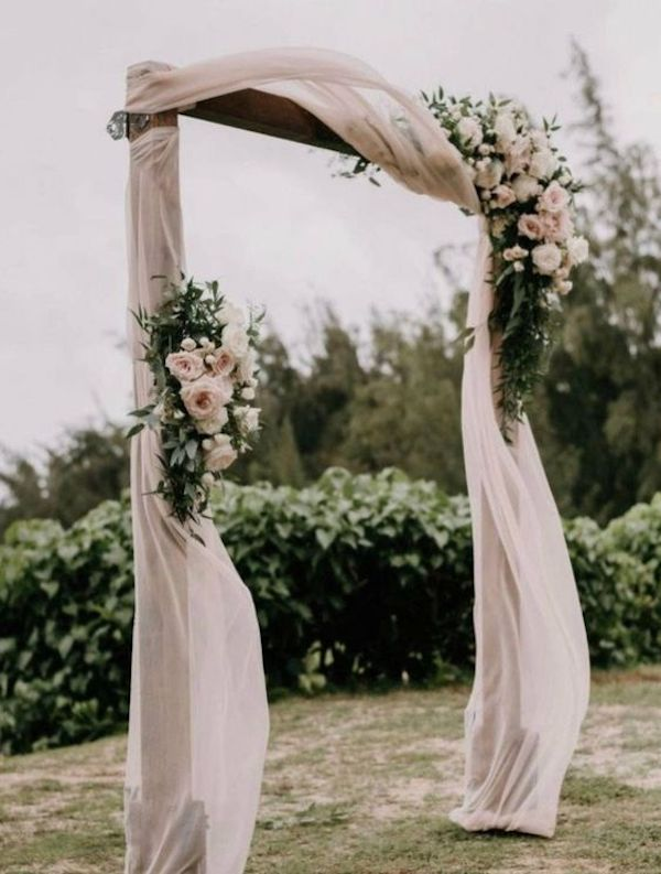 blush pink backyard wedding arch ideas