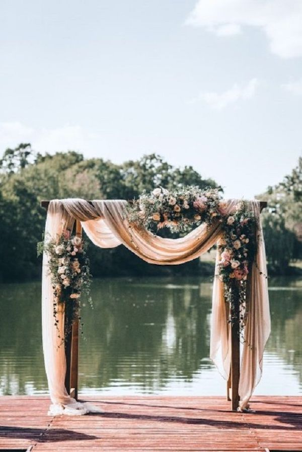 dusty rose backyard wedding arch ideas
