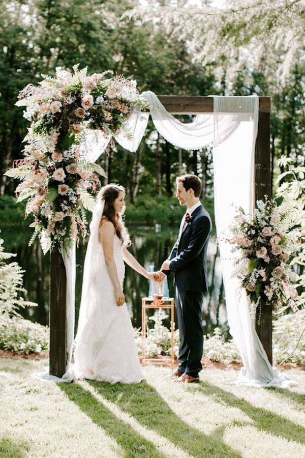 gorgeous floral and white drapery wedding arch ideas