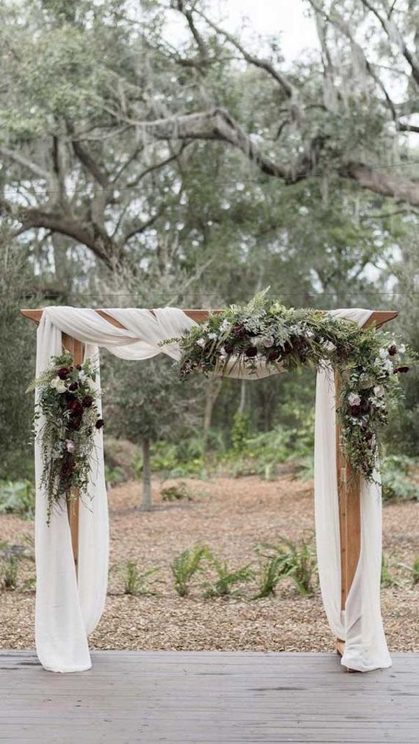 greenery and white drapery wedding arch ideas