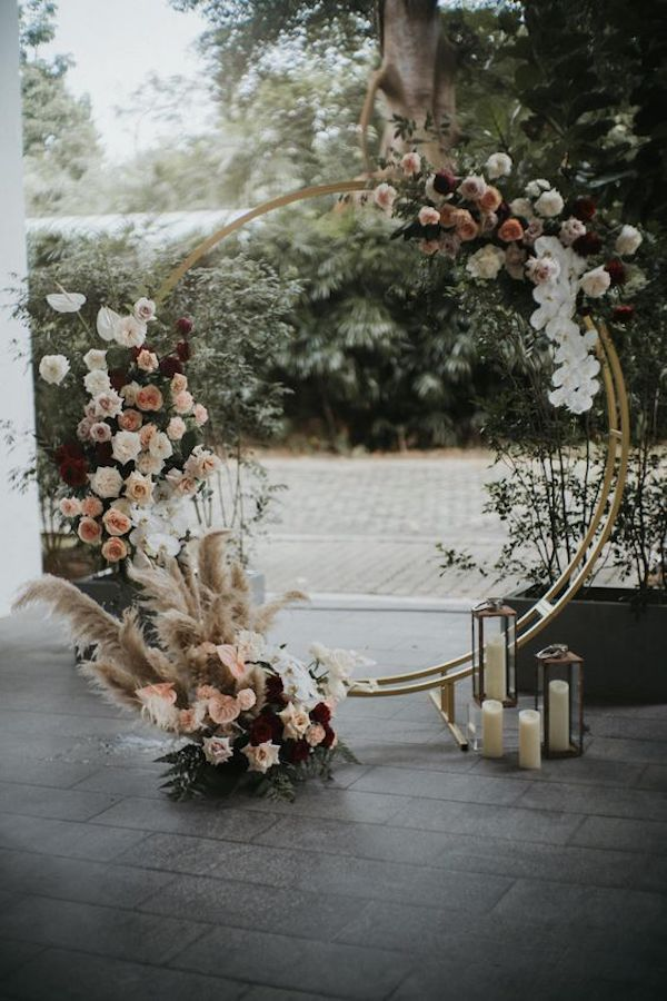 rounded wedding arch idea swith floral