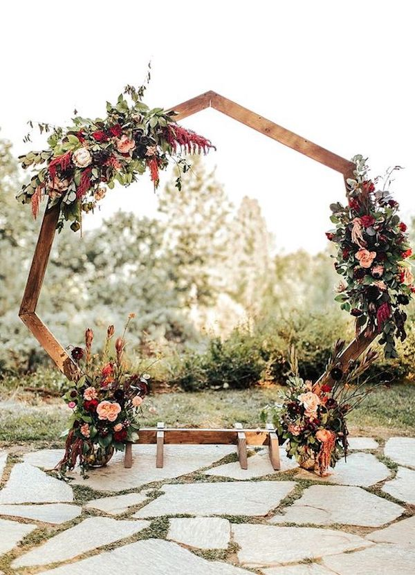 wooden geometric and floral wedding arch ideas