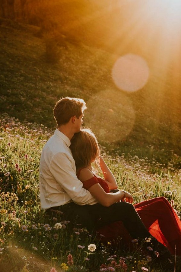 sitting among the wildflowers engagement photo ideas